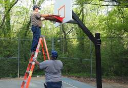 Staff of Robert Jennings, park superintendent for Durham Parks and Recreation, closing basketball courts amid COVID-19. Photo courtesy of Cynthia Booth.