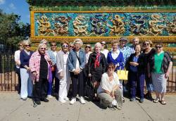 Tricia Schwall (front, kneeling), program manager for Dickinson Hall-Lake Forest Lake Bluff Senior Center, with program participants in Chicago's Chinatown. Photo courtesy of Tara Purtell.