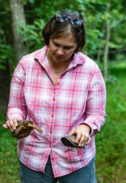 Bonnie Gray, environmental recreation specialist for Prince William County Dept. of Parks, Recreation & Tourism, holding two turtles. Photo courtesy of Dianne Wahl.