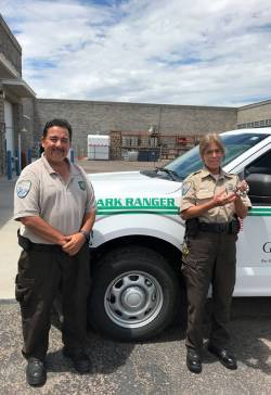 Jody Becker (right), park ranger for Gilbert Parks and Recreation, standing with Brian Hiapo, wildlife rescue. Photo courtesy of Sarah Sharits.
