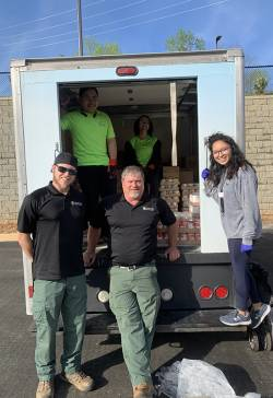 Joe Pruitt (front, center), natural and cultural resources section coordinator for Gwinnett County Parks and Recreation, with his staff and a truck with food for people impacted by COVID-19. Photo courtesy of Mark Patterson.
