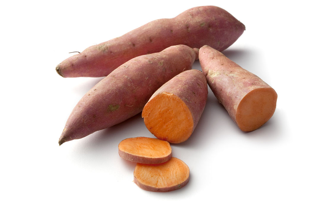 Raw sweet potato with some sliced pieces