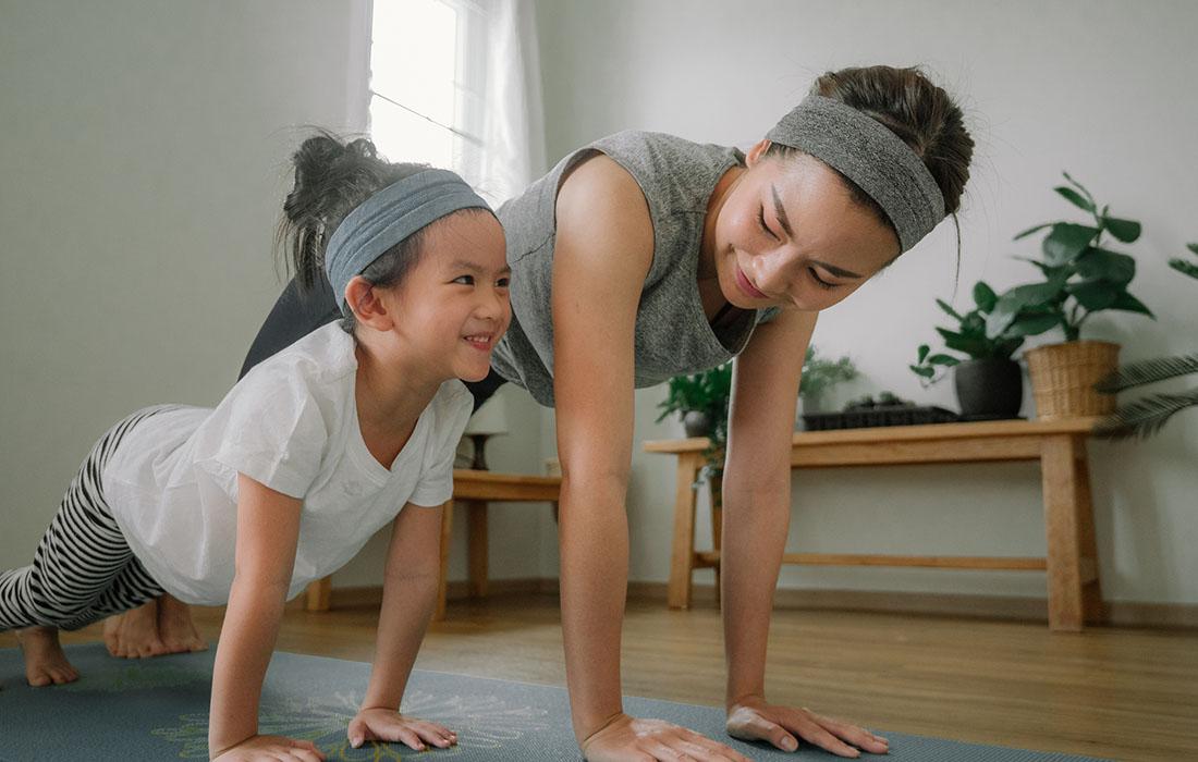 mum and baby doing yoga