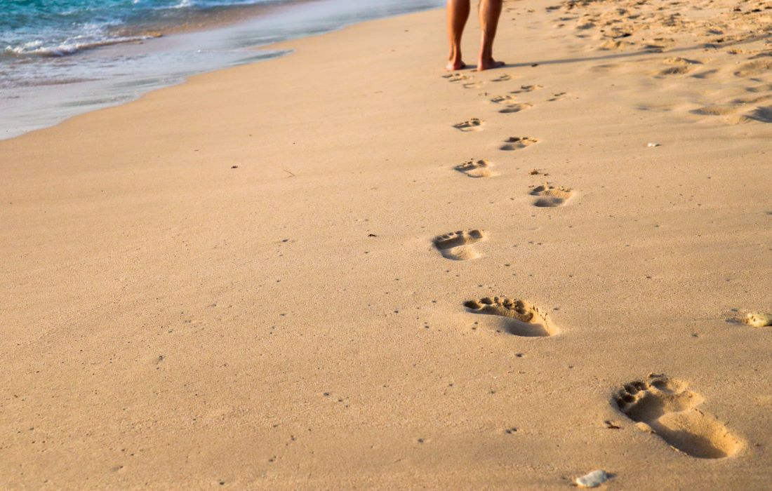 walking on the beach leaving footprints