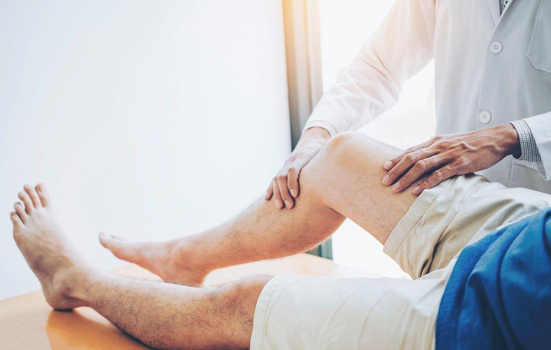 Physio treating an injured knee