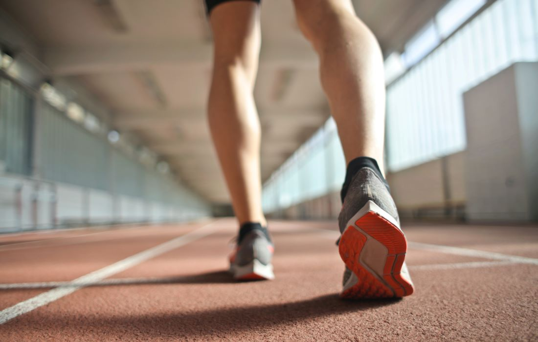 athlete walking on a track