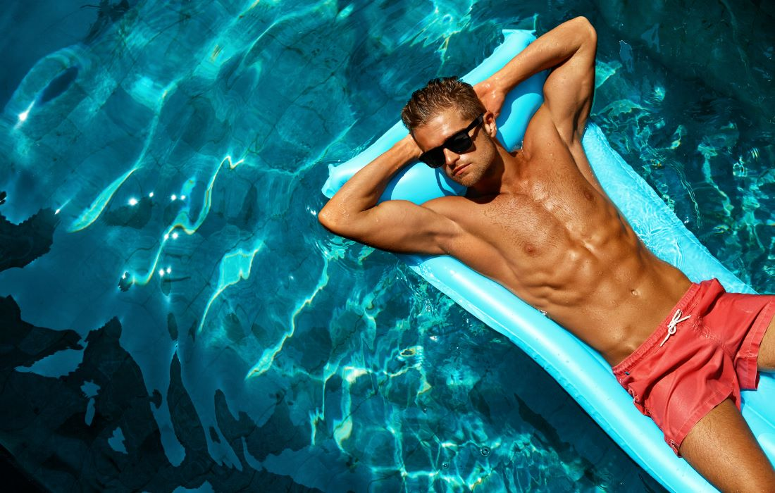 man relaxing on a pool float