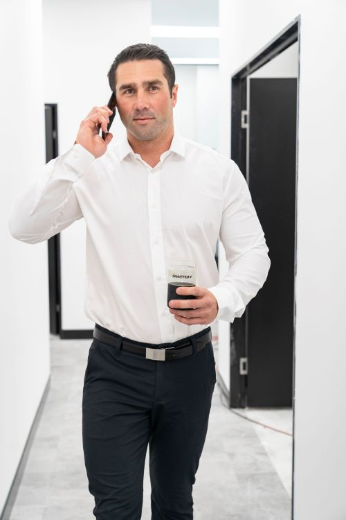 office worker walking with coffee