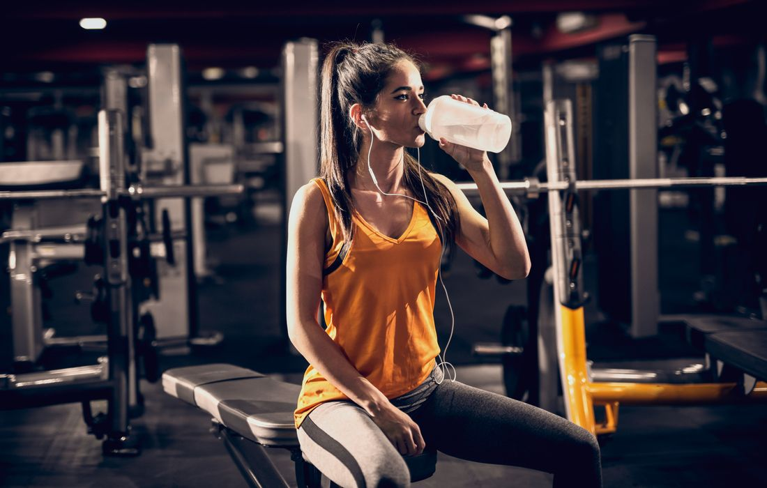 woman drinking supplement