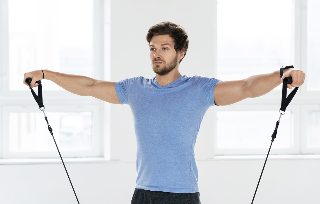 3 Resistance Band Moves To Sculpt Your Shoulders