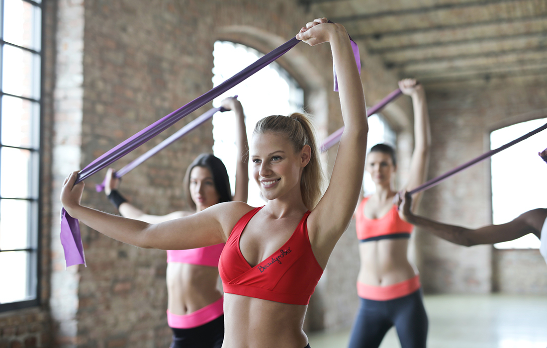 women doing a group exercise class