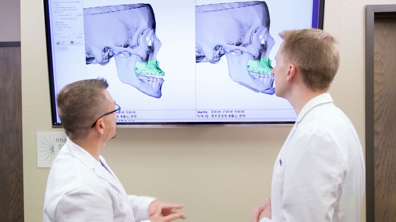 Dr. Bryan and Dr. Goodson examine a 3D scan of a skull in Oklahoma City, OK