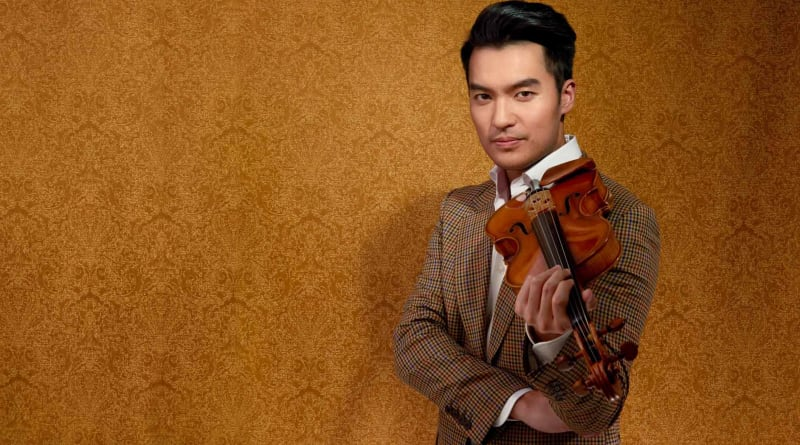 Ray Chen holds a violin