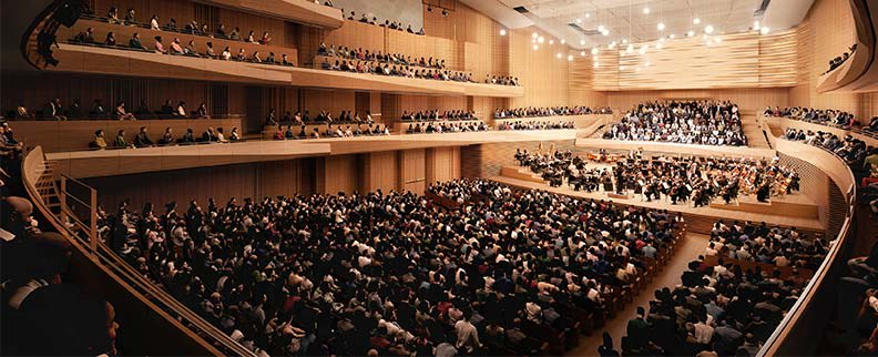 A rendering of the renovated David Geffen Hall showing the orchestra on stage and the audience sitting in the round