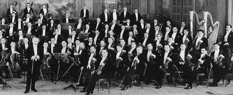 Historic, black and white photograph of New York Philharmonic orchestra
