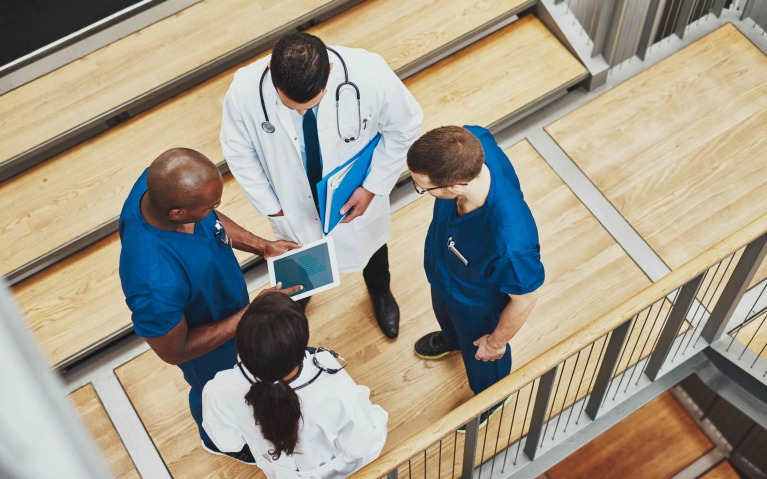 Physicians and nurses collaborate