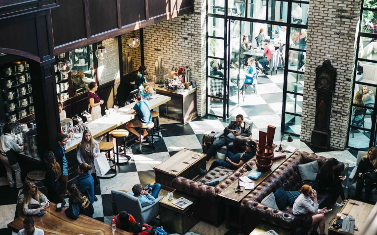 oag-living-in-portland-economy-sheets-people-in-cafe