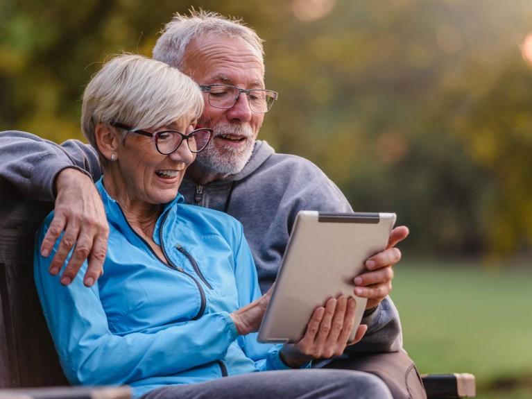 Older couple reads tablet