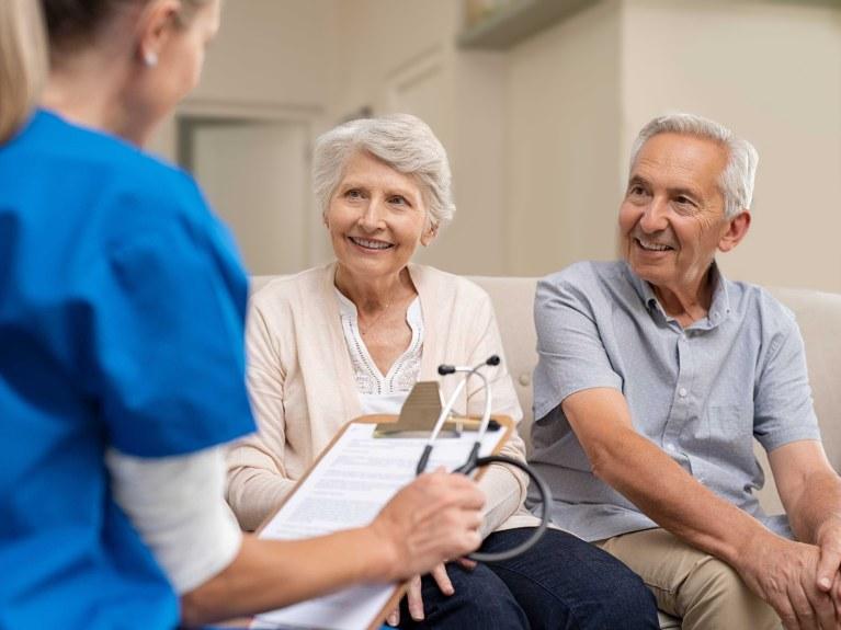 elderly couple consulting practioner