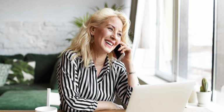 oad-pay-my-bill-contact-us-middle-aged-woman-laughing-on-phone