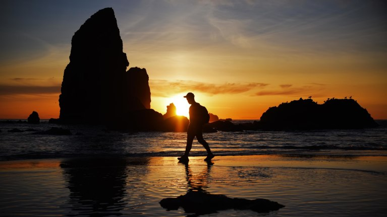 oag-for-anesthesiologists-living-in-oregon-card-man-walking-on-beach-at-sunset