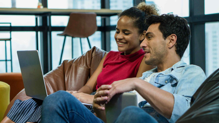 oag-billing-contact-us-young-couple-pointing-and-looking-at-computer