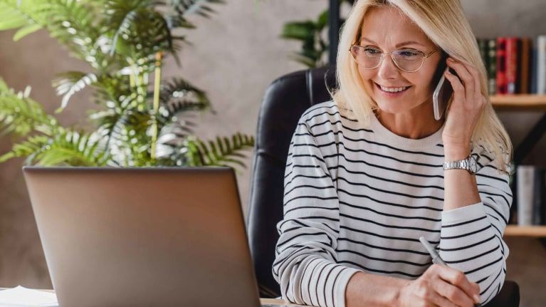 oag-business-support-woman-talking-on-phone-a-desk
