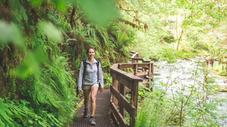 woman hiking at silver falls oregon