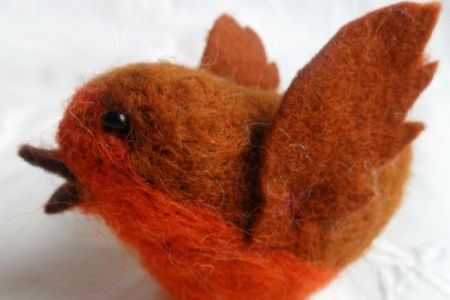 Learn how to create cute and festive needle felted robins and baubles