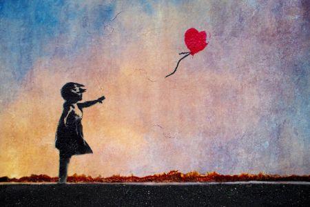 Balloon flying girl by Banksy