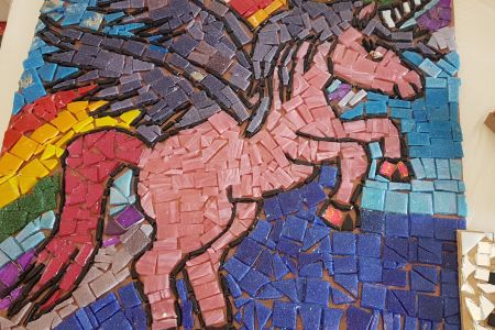 Learn the basic skills of mosaic making, including how to cut safely using mosaic tools and how to plan and place your pieces for maximum effect.