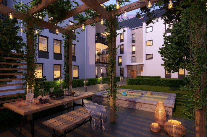 Grönskande uteplats vid ett lägenhetskomplex