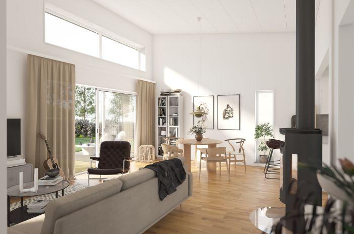 Öppen planlösning och stora fönster i vardagsrum i Brf Lyckan.