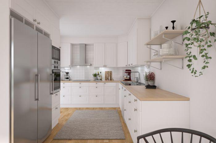 Kyl och frys i kök med öppen planlösning