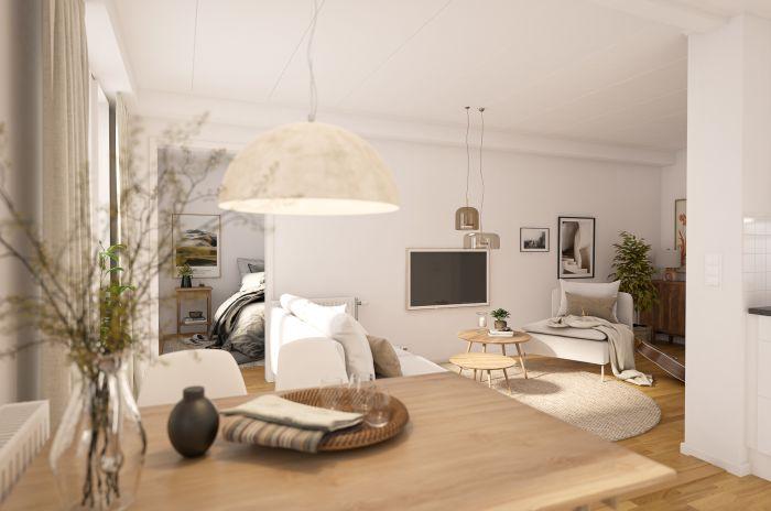 Ett vardagsrum med öppen planlösning