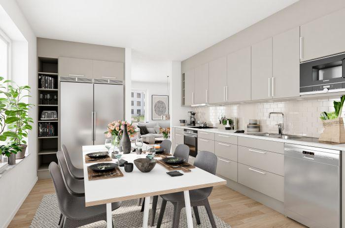 ett ljusgrått kök med öppen planlösning