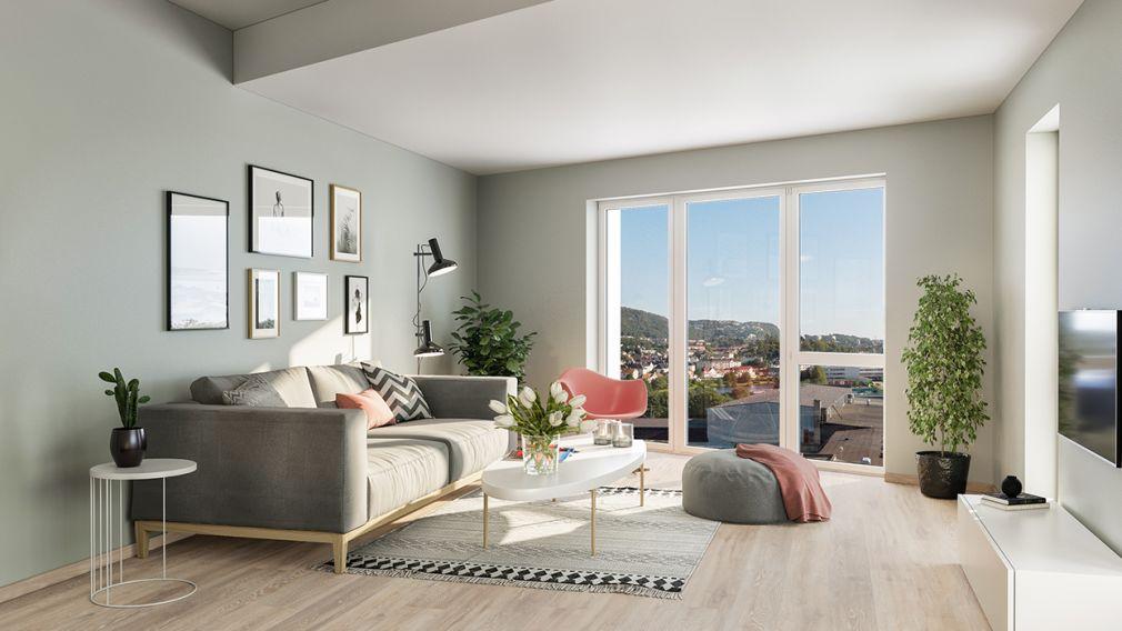 Bilde fra stue med utsikt over by og mot fjell