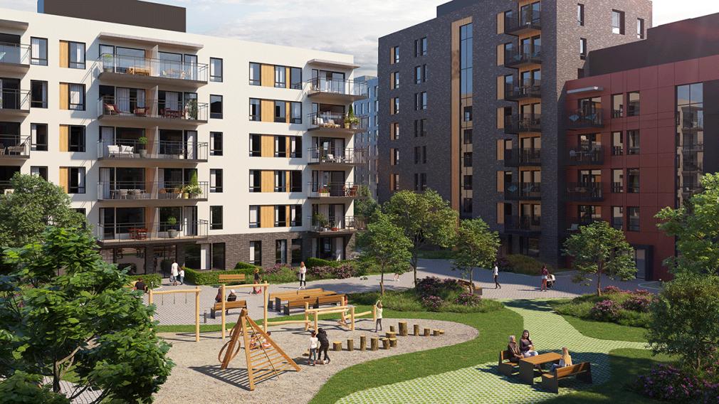 Bilde av grønt fellesareale med lekeplass og boligblokker