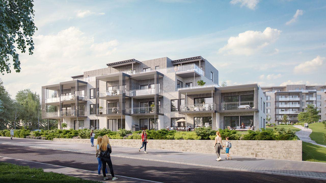 Bilde av boligblokk med store terrasser, beplantning og gangfelt