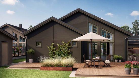 brunt hus med tillhörande trädgård och altan