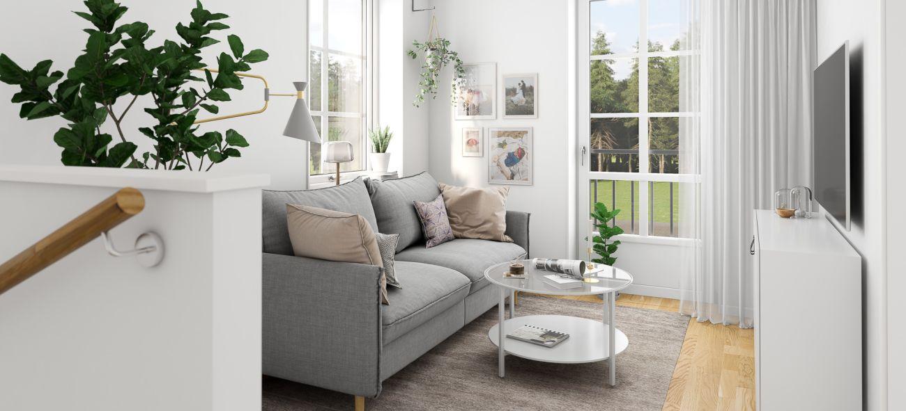 ljust tv-rum med grå soffa