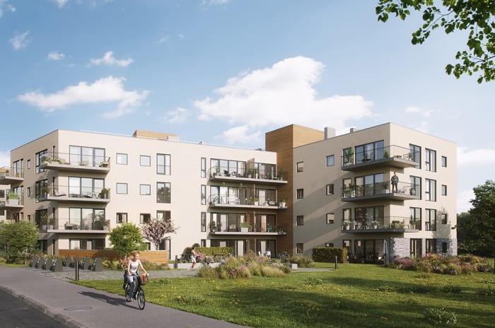 lyse boligblokker med balkonger og grøntområder