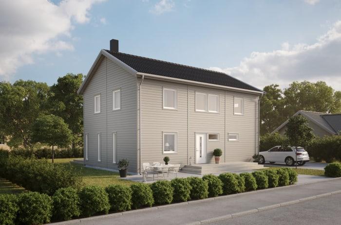 stor vit villa med två plan.