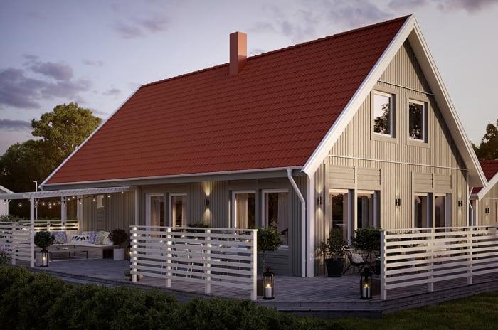 grå villa i trä med terrass