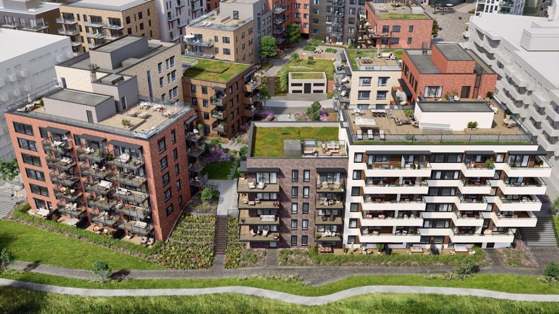 Oversiktsbilde av boligblokker på Vollebekk med gangveier og grøntområder