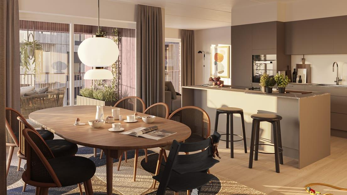 Kjøkken med kjøkkenøy og spisestueplass, samt utgang til balkong i en femromsleilighet på Nansenløkka.