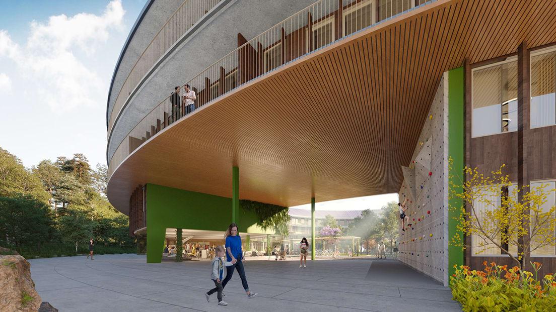 Boligprosjektet Oen's fasade, uterom og inngang sett utenfra på dagtid.