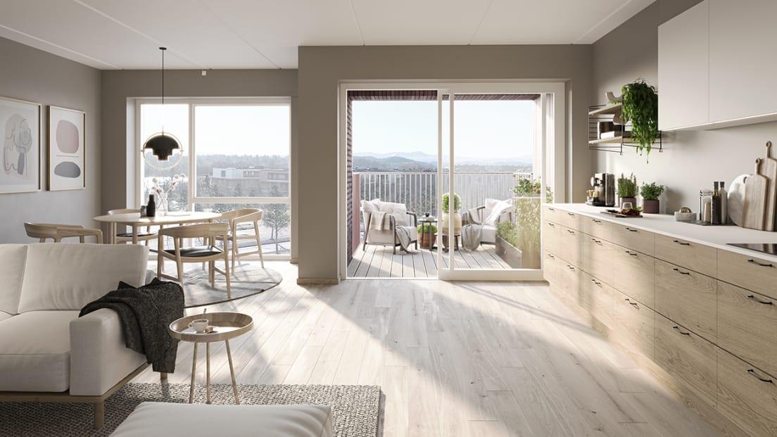 Stue, kjøkken og spisestueplass med utgang til balkong på dagtid, i Nansenløkka.