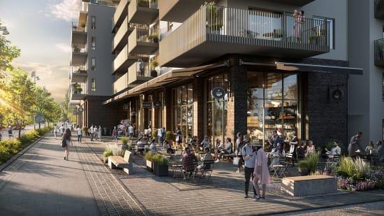 Fasaden til MIDT med serveringssteder i solnedgangen.