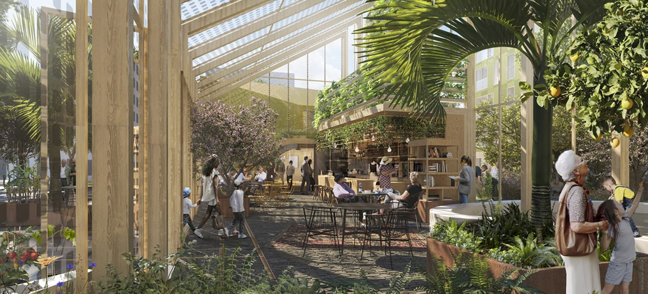 myldreområde med mennesker, planter, kaffebar og sitteplasser
